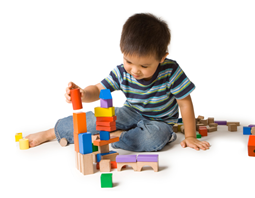 Little boy playings with blocks