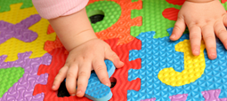 Baby's hand on play mat
