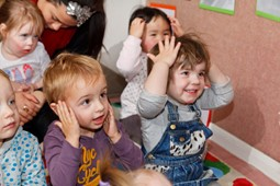 Children with hands on their heads