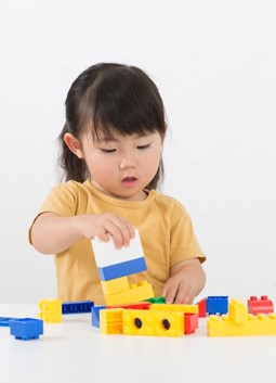 Little girl playing with Lego