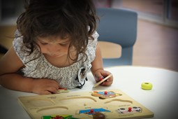 Young girl playing a puzzle