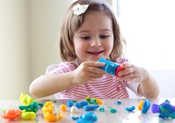 Young girl playing with Play-doh